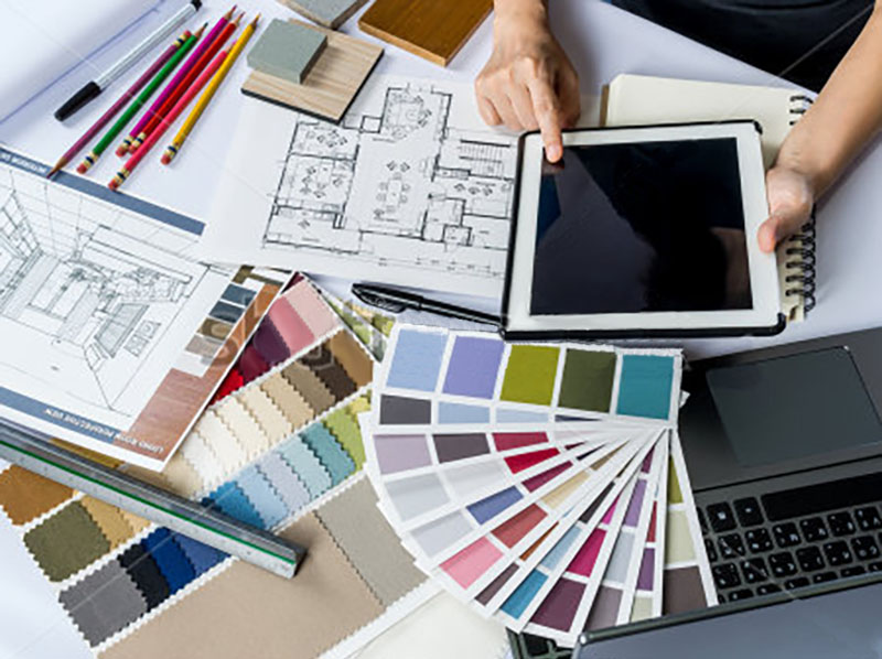 stock-photo-top-view-of-architects-hands-working-with-tablet-computer-material-sample-on-desk-304391483